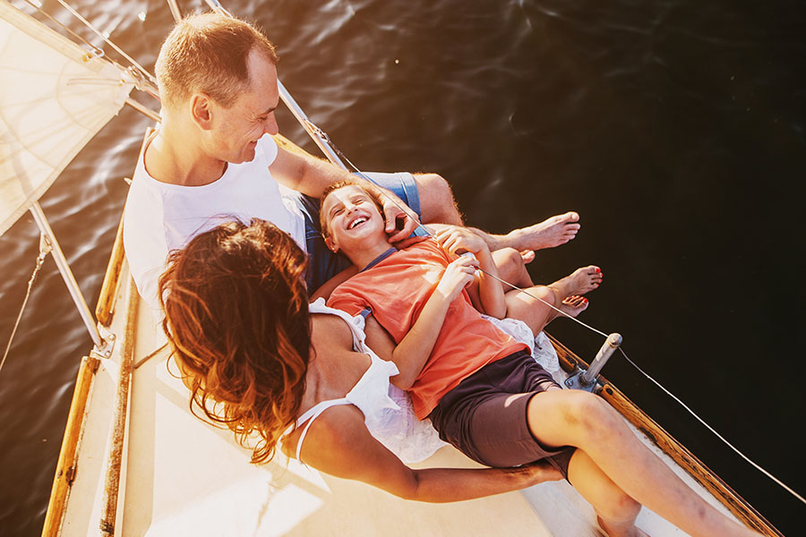Personal Insurance - Excited Family Hanging Out on a Boat